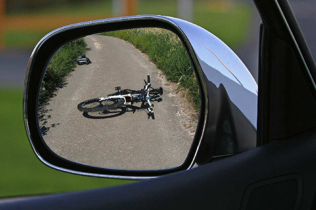 Bike On Road Viewed In Wing Mirror